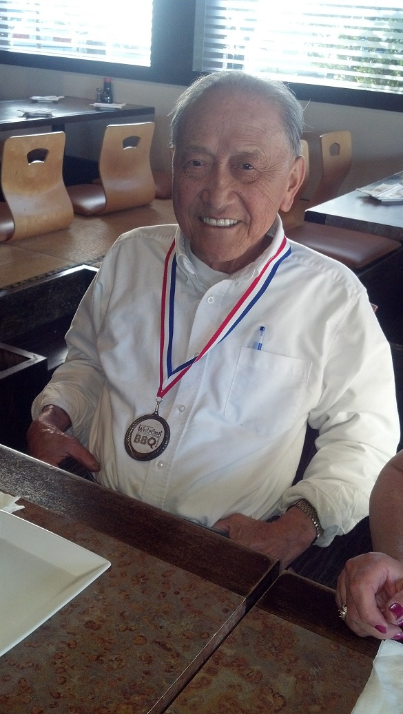 Donald Fong with medal from Long Beach, 2014