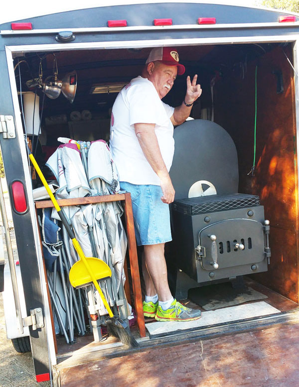 Doug helping Mike Davis haul his smokers in Doug's trailer up to the set location