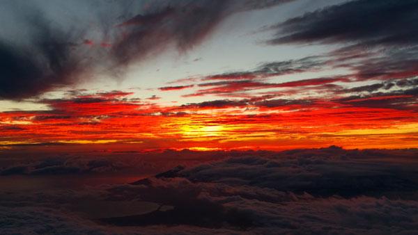 Maui sunset from Haleakala volcano peak 10,000 feet