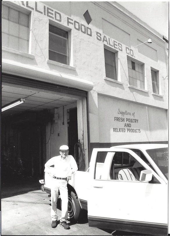 Donald Fong in front of Allied Meats of Oakland in 1990's