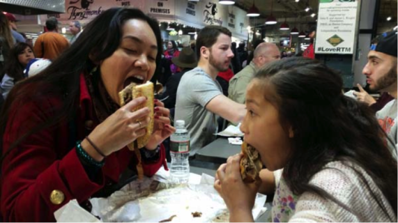 At Reading Terminal Market in Philadelphia (Amy & Miranda with Philly Cheese-steaks)